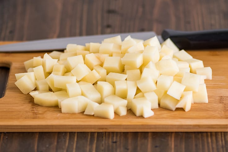 Mashed Potatoes for Two Photo Step 2: chopped potatoes on a cutting board.