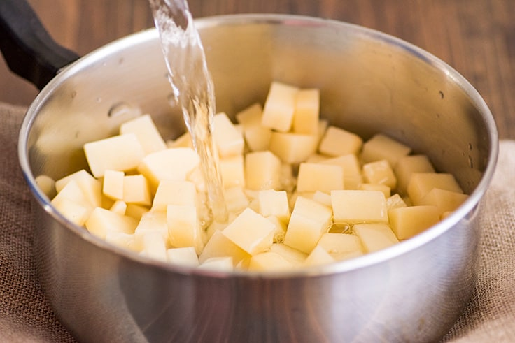 Mashed Potatoes for Two Photo Step 3: cold water being added to cubed potatoes.