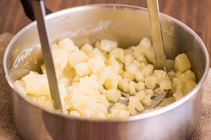 Mashed Potatoes for Two Photo Step 4: potatoes being mashed.