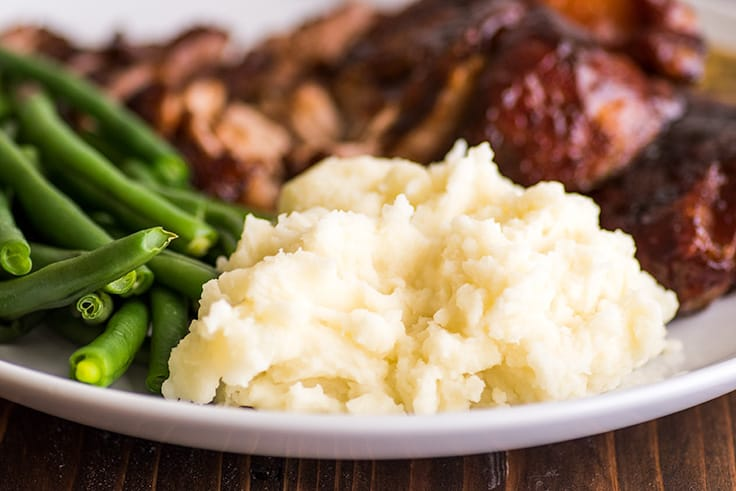 Mashed Potatoes for Two on a plate with ribs and green beans.