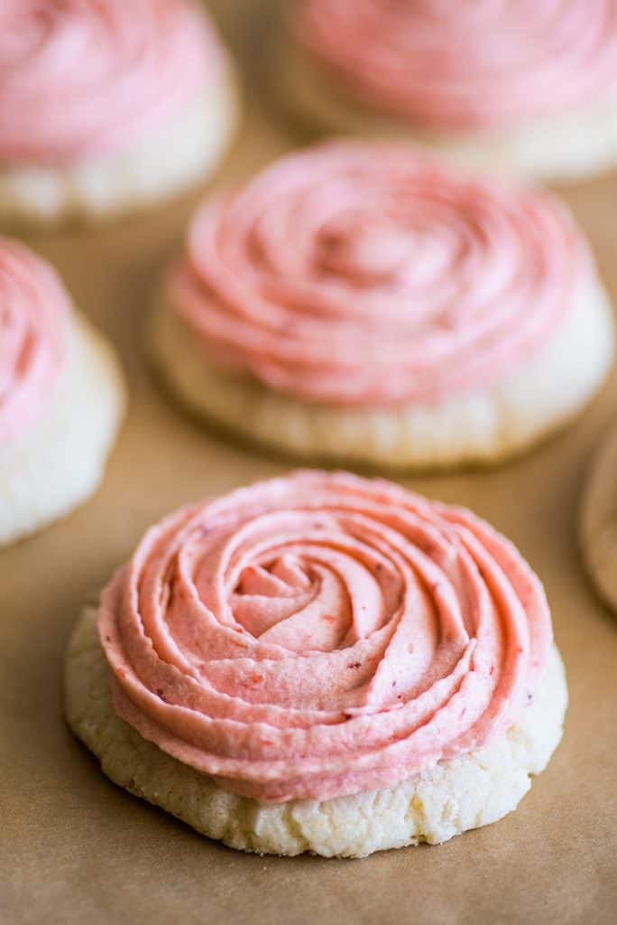Image of Strawberry buttercream frosting on sugar cookies.