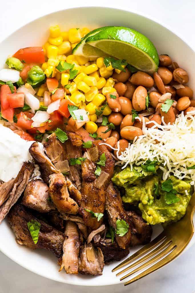 Overhead shot of Carnitas Burrito Bowls in a white bowl.
