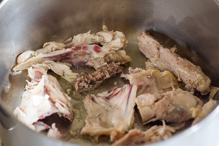 Photo of Chicken Carcass Soup Step 1: cut chicken bones in a pot.