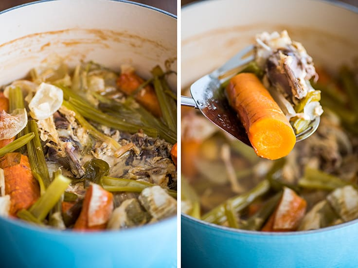 Picture of homemade chicken stock bones and vegetables after being simmered.