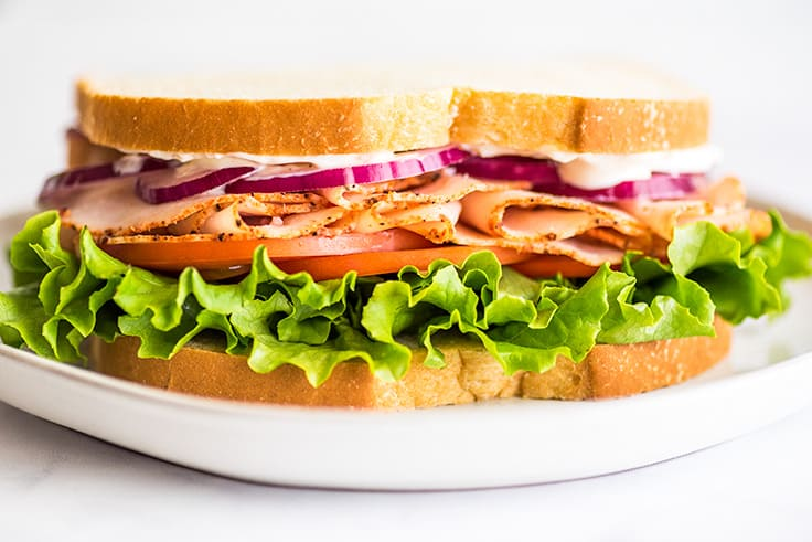 Picture of a turkey sandwich made with garlic aioli.