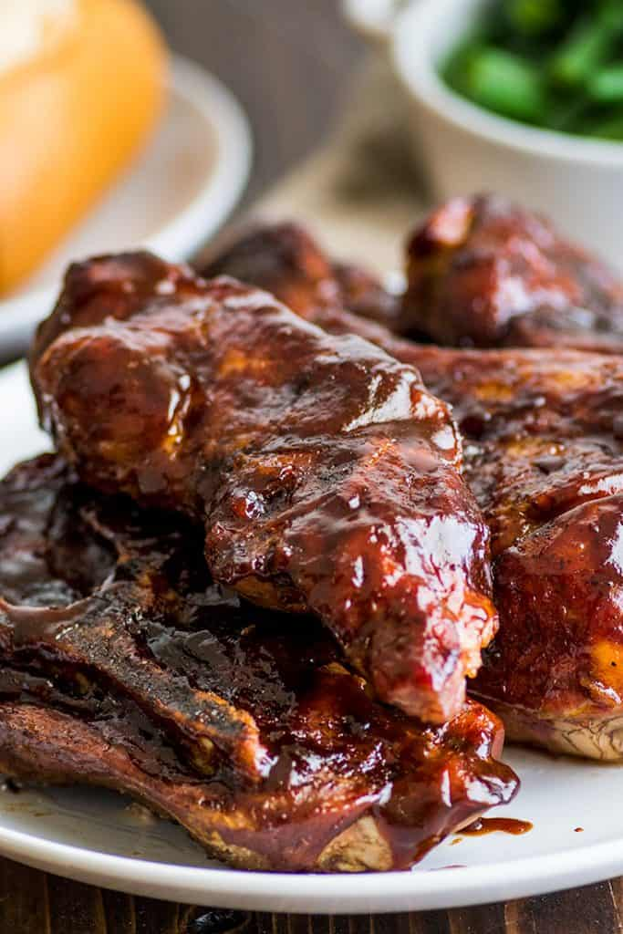 Photo of country-style pork ribs piled on a plate.