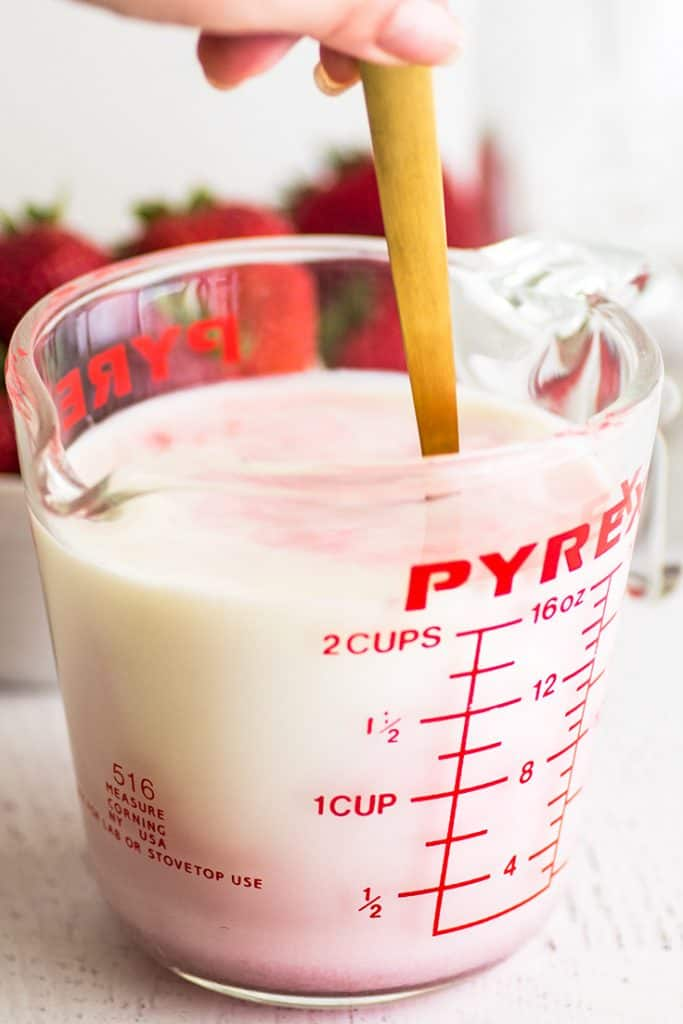 Photo of homemade strawberry milk being mixed up.