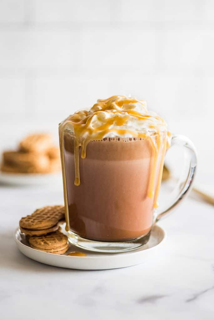 Picture of Peanut Butter Hot Chocolate on a white plate with Nutter Butter Cookies.
