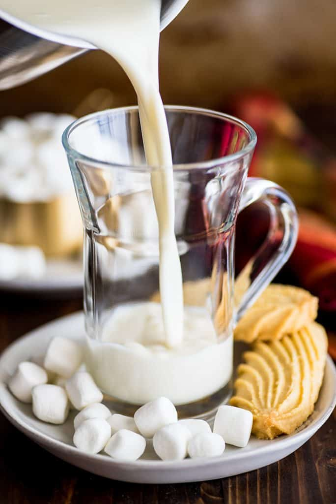 Picture of White Hot Chocolate being poured into a glass mug.