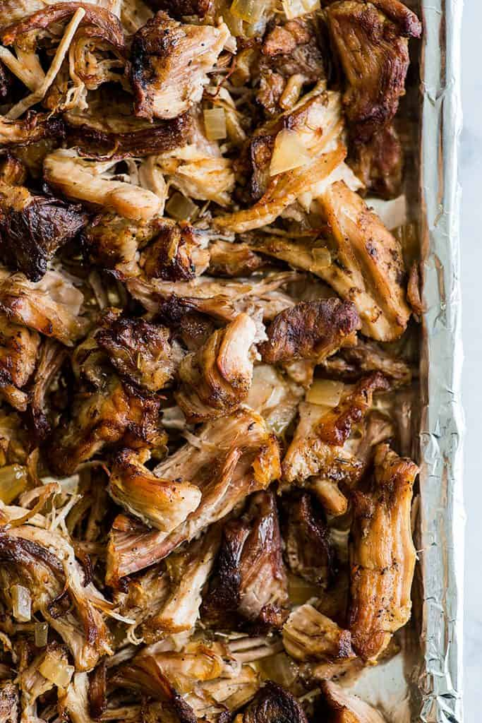 Crispy Slow Cooker Carnitas on a baking tray.