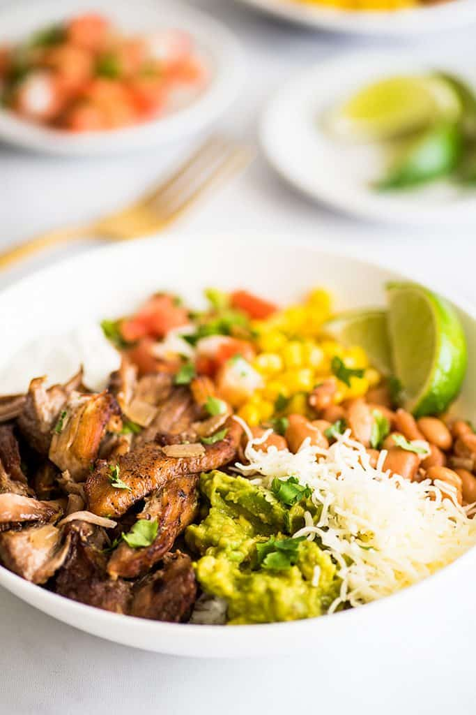 Crispy Slow Cooker Carnitas in a burrito bowl.