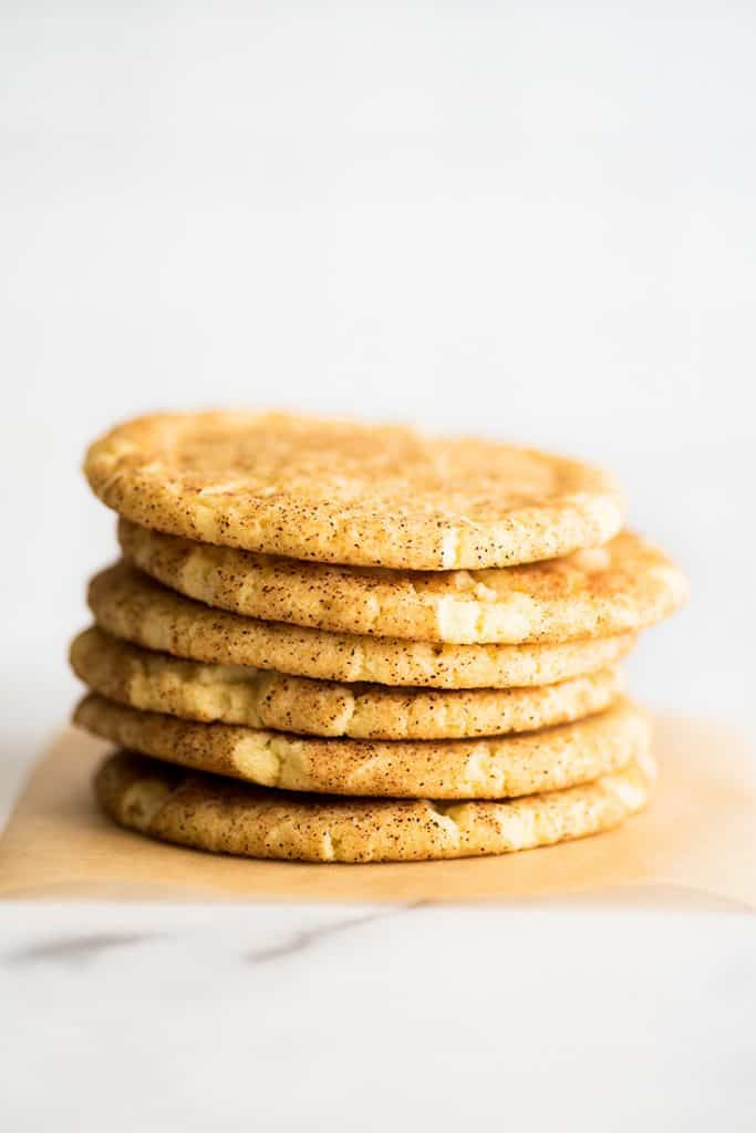 Stack of Small-batch Snickerdoodles on parchment paper.