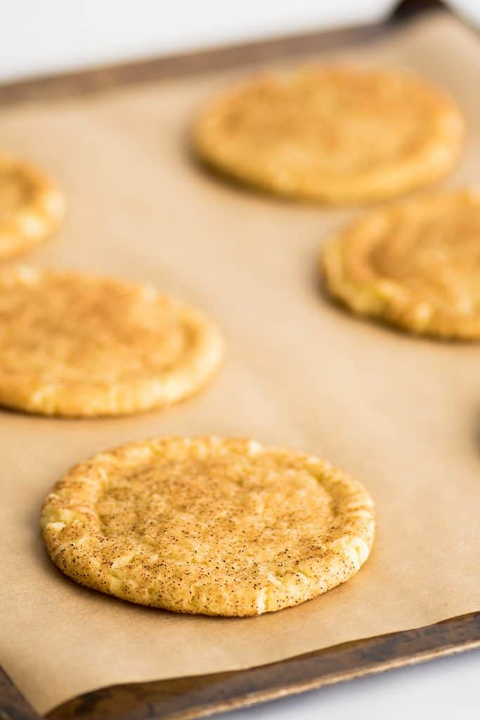 Small-batch Snickerdoodles on parchment paper.