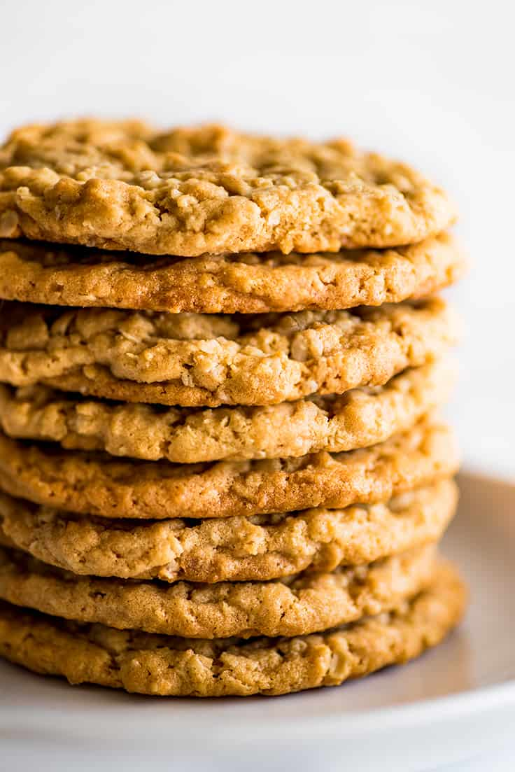 Stack of Peanut Butter Oatmeal Cookies on a white plate.
