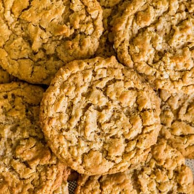 Photo of Peanut Butter Oatmeal Cookies in a pile on a cookie sheet.