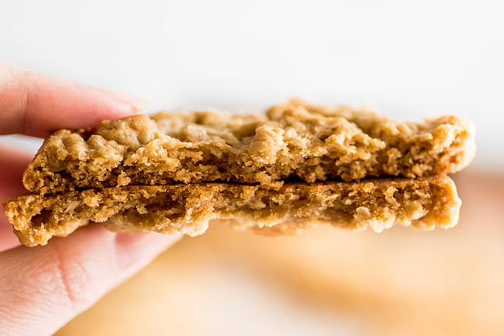 Close up photo of Peanut Butter Oatmeal Cookie split in two.
