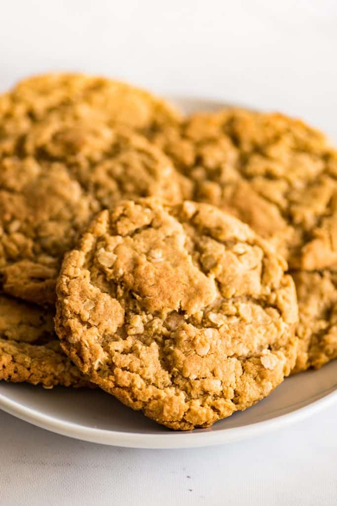 Pile of Small-batch Peanut Butter Oatmeal Cookies of a white plate.