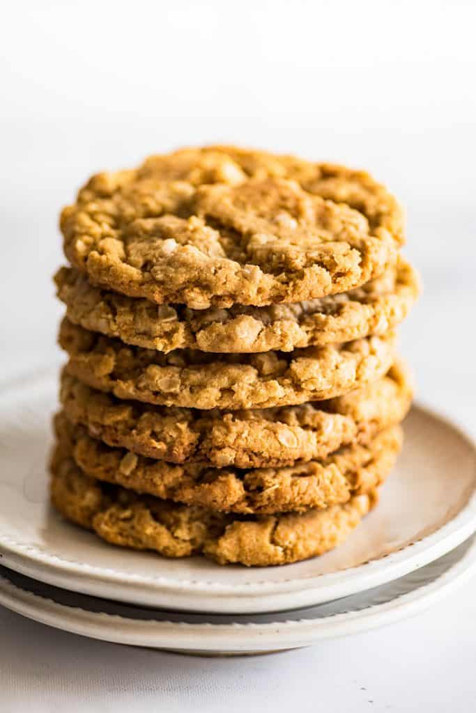 Picture of a stack of Small-batch Peanut Butter Oatmeal Cookies on a white plate.