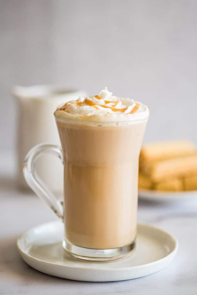 Dulce de leche latte on a glass cup.