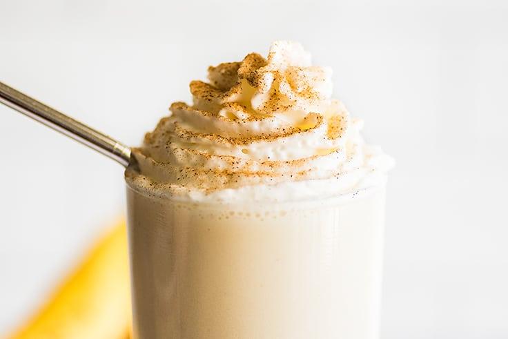 Banana milkshake with whipped cream and cinnamon sugar.