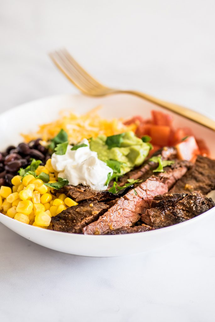 Photo of Carne Asada Burrito Bowl in a white bowl.