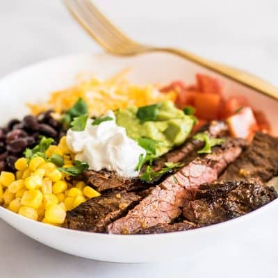Photo of Carne Asada Burrito Bowl in a white bowl.