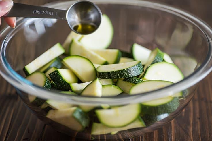 Sliced zucchini in a bowl.