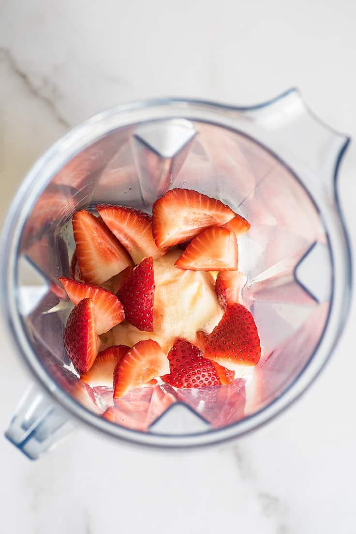 Strawberry Milkshake ingredients in a blender