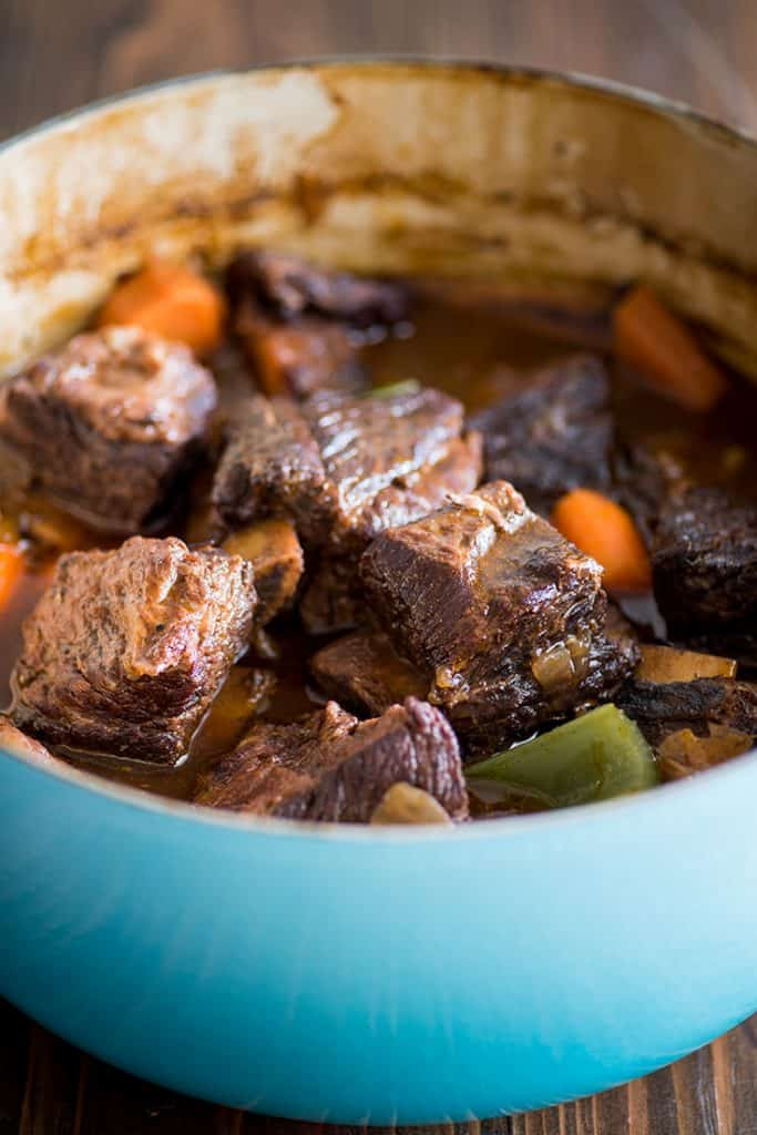 Picture of easy braised short ribs in a blue pot.