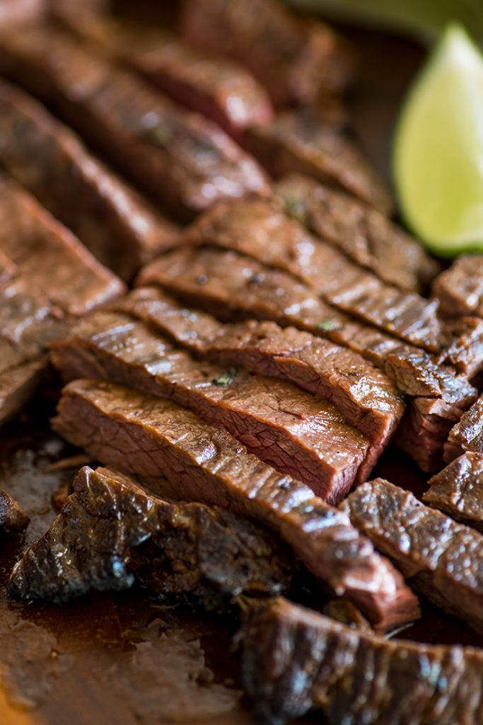 Picture of Carne Asada cooked to medium and sliced.