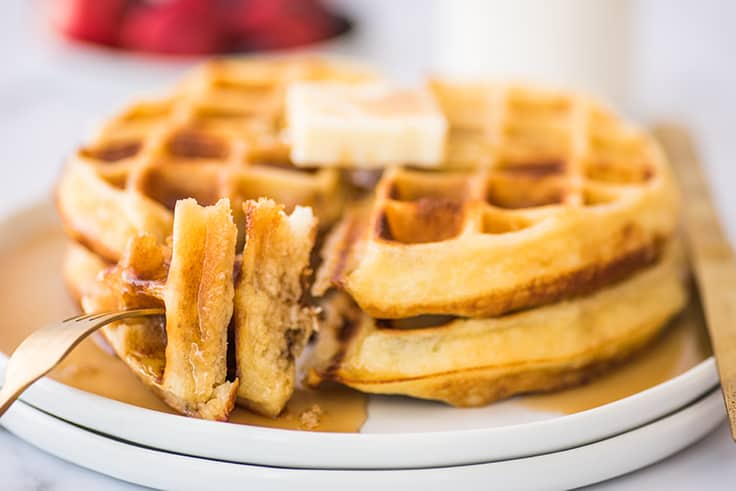 Pieces of crispy waffles on a fork.