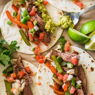 Overhead photo of steak fajitas on parchment paper.