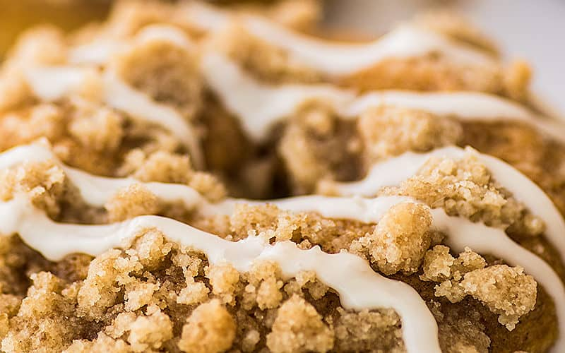 Pumpkin donuts with streusel and glaze drizzle.