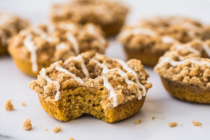 Pumpkin Donut With Streusel with a bite out of it.