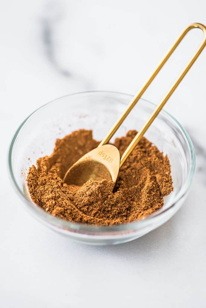 Homemade pumpkin pie spice mix in a glass bowl.