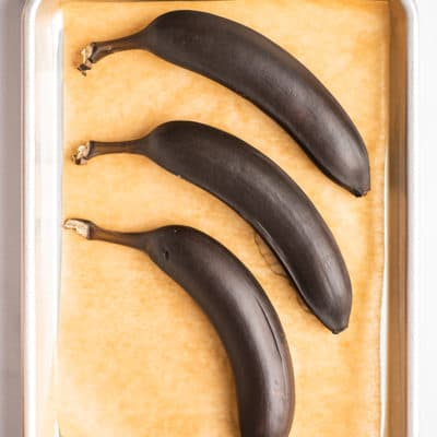 Bananas ripened in the oven on a baking sheet.