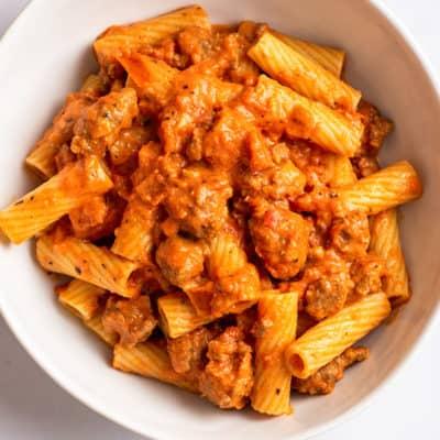 Creamy sausage pasta sauce over rigatoni pasta.