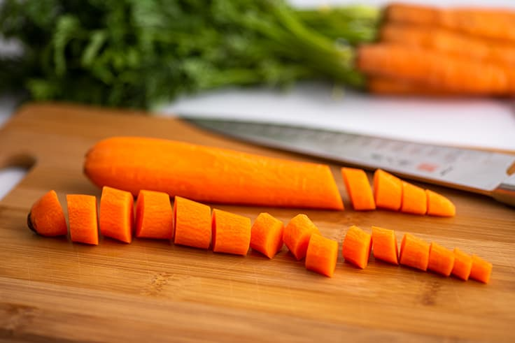 Chopped carrots on a cutting board.