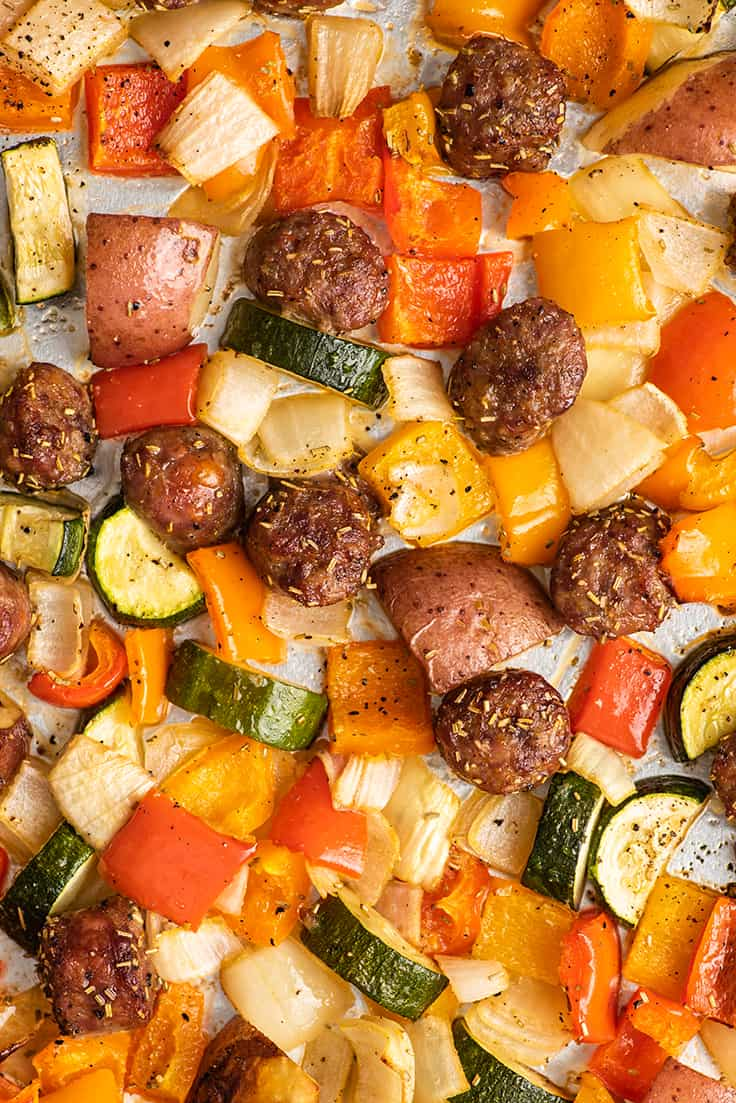 Sausage and vegetables on a sheet pan.