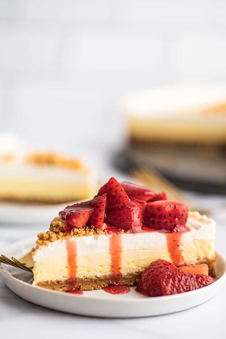 Slice of easy cheesecake with strawberry sauce.