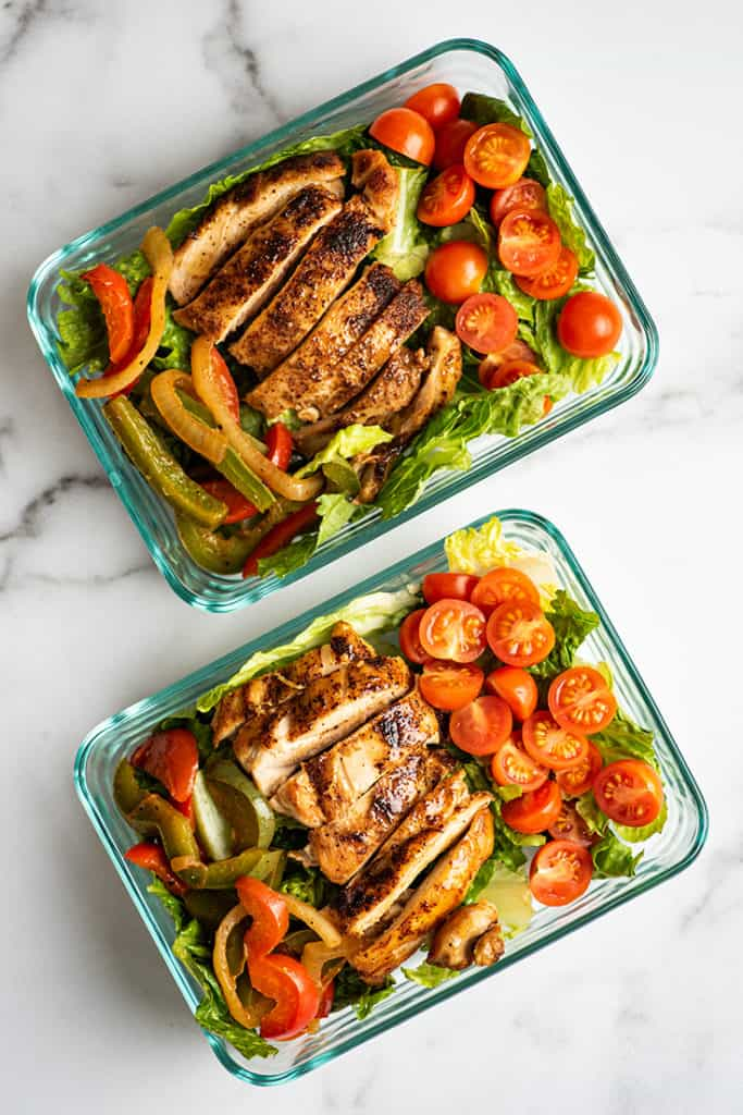 Chicken fajita salad in meal prep containers.
